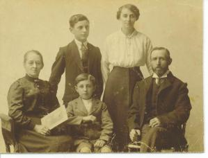 Dad as a small boy with his parents and two of his older siblings, c. 1916