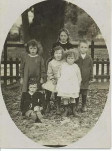 Mum (in the boots and droopy drawers) with some of her siblings at infant school, c. 1917