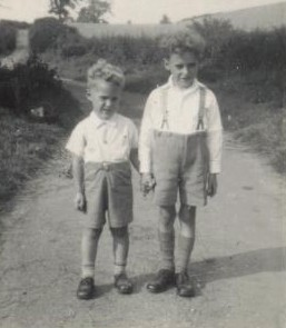 Me (right), generously trousered to allow for growth, and Derk. C. 1951