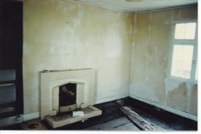 The sitting room as I found it. Grim!